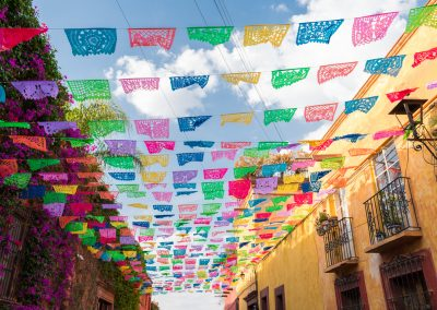 Colorful paper flags over street on a sunny day
